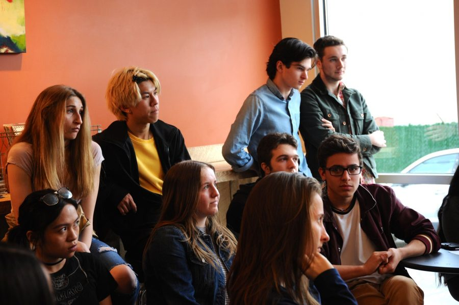 Above: WOHS students watch their peers recite poems (Photo: Sarah Kravits).