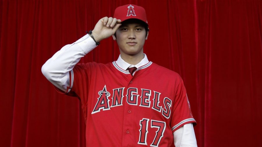 Baseball+player+Shohei+Ohtani%2C+of+Japan%2C+poses+for+photos+after+a+news+conference+at+Angel+Stadium%2C+Saturday%2C+Dec.+9%2C+2017%2C+in+Anaheim%2C+Calif.+The+Japanese+star+is+bringing+his+arm+and+bat+to+the+Los+Angeles+Angels%2C+pairing+him+with+two-time+MVP+Mike+Trout.+%28AP+Photo%2FJae+C.+Hong%29