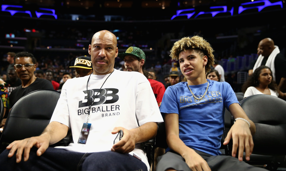 LOS ANGELES, CA - AUGUST 13:  (L-R) Lavar Ball and LaMelo Ball look on from the audience during week eight of the BIG3 three on three basketball league at Staples Center on August 13, 2017 in Los Angeles, California.  (Photo by Sean M. Haffey/Getty Images)