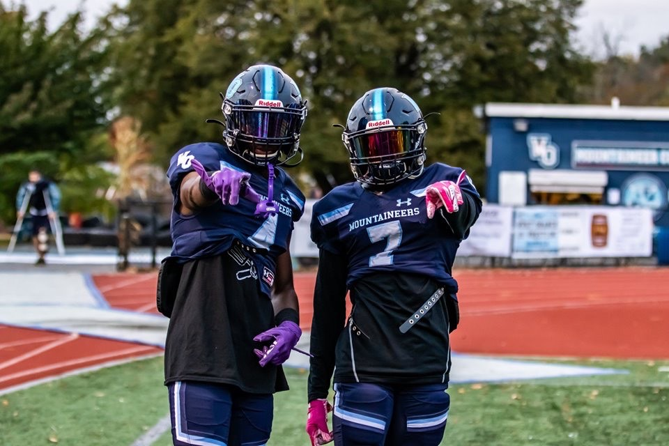 Photo Credits to Larry Washington: Amiyn Hanks #4 and Jahmil St. Pierre #7 of West Orange step onto the field for pregame warm-ups.