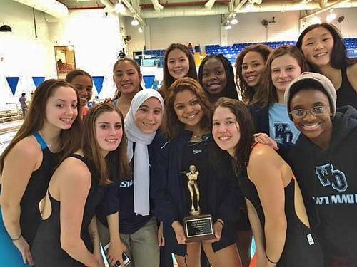 The girls swim team last year after winning the Super Essex Conference championship.
