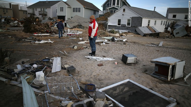 David+Mccue+%28C%29%2C+looks+for+pieces+of+his+beach+house+that+was+completely+demolished+by+Superstorm+Sandy+on+November+25%2C+2012%2C+in+Seaside+Heights%2C+New+Jersey.
