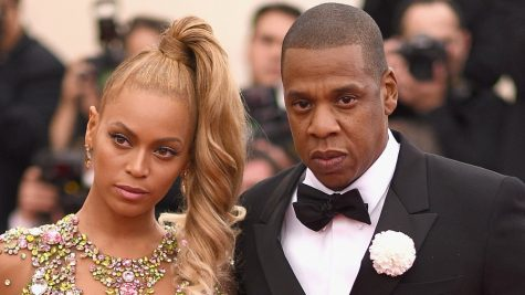 Beyonce and Jay-Z draw criticism by sitting during the national Anthem