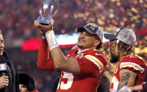 Patrick Mahomes holding up the Lombardi Trophy after winning Super Bowl 54