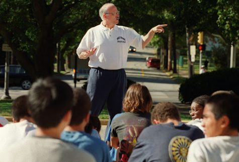 Joe Suriano, former cross country coach at West Orange High School, meets with his team the day before a conference meet in 2000