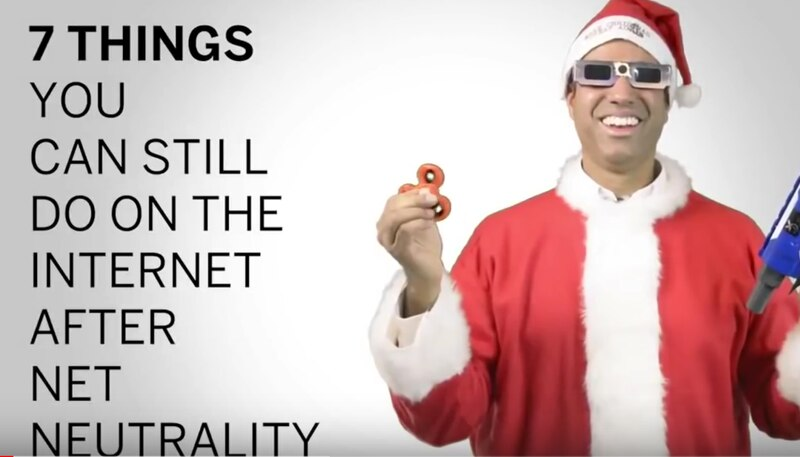 Pictured above is Ajit Pai, the Chairman of the Federal Communications Commission wearing a Santa Clause Suit and holding a fidget spinner-- all in attempt to convince people that he is a common man. He was designated Chairman by President Donald J. Trump in January 2017