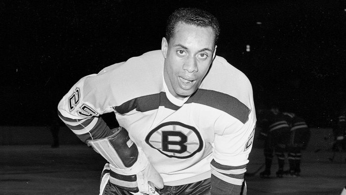 25-year-old left wing Willie O'Ree, the first black player of the National Hockey League, warms up in his Boston Bruins uniform, prior to the game with the New York Rangers, at New York's Madison Square Garden, on November 23, 1960.  (AP Photo)