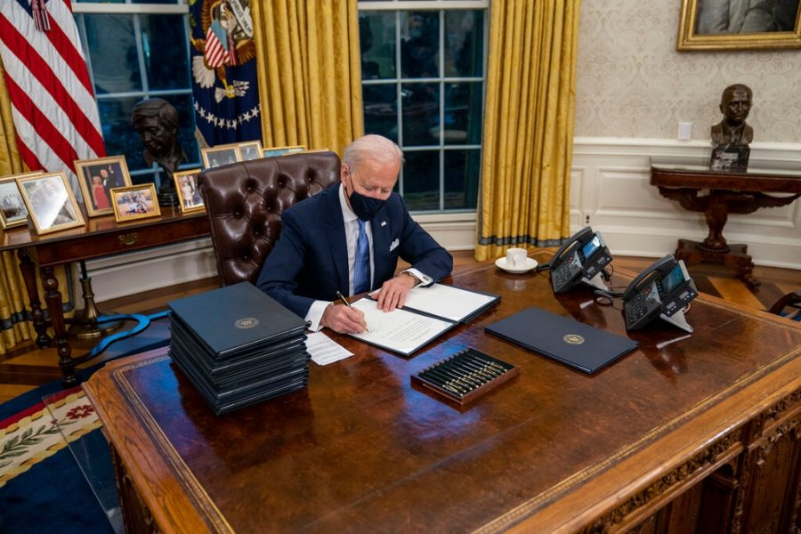 President Biden signed executive orders during his first few minutes in the Oval Office on Wednesday.Credit...